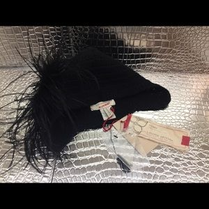 BCBG runway scull cap with detachable feather puff